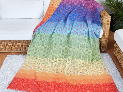 Produkt: Decke in Regenbogenfarben und dem Symbol der Blume des Lebens